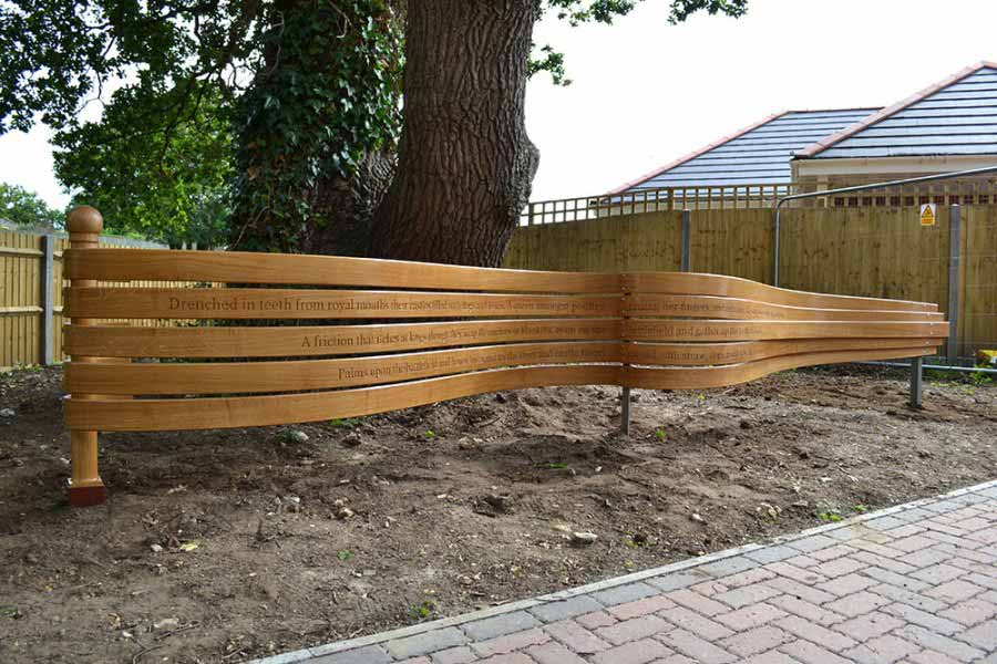Curved oak pennant in situ made as a public sculpture. Made with five strips of curved oak.