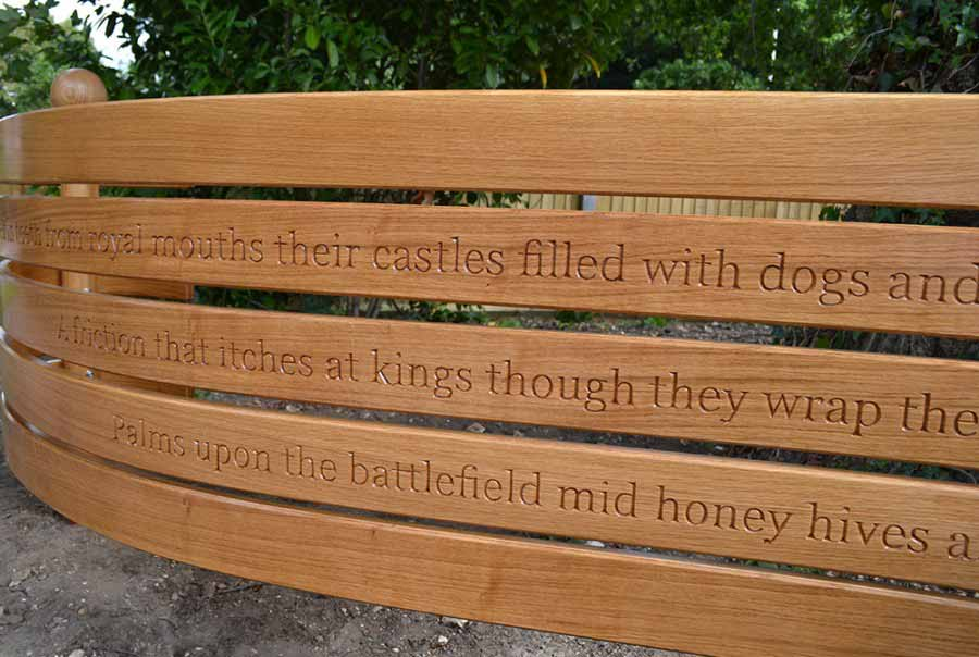 Detail of the sculpture showing part of the poem hand carved into the front surface.