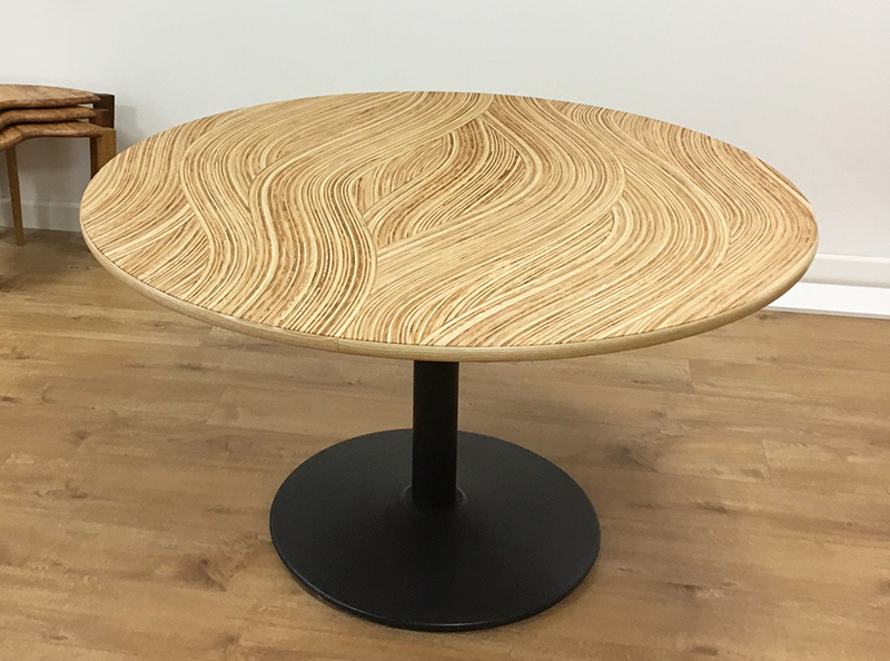 Office meeting table with the top made from our own wavy Murano veneers in ash and olive ash.