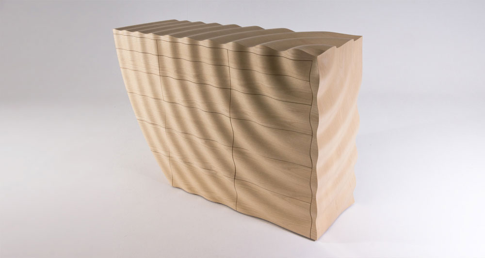Ripples chest of drawers with a rippled surface to the exterior made in ash. The ripple pattern starts from the top right corner and flow outwards to engulf the whole piece.