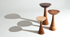 Set of three mushroom shaped side tables of different heights in ash, walnut and elm.