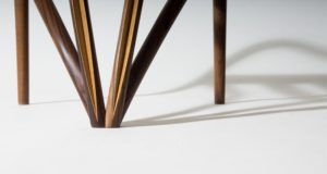 A detail of the oak and walnut legs of our Splay carver dining chairs.
