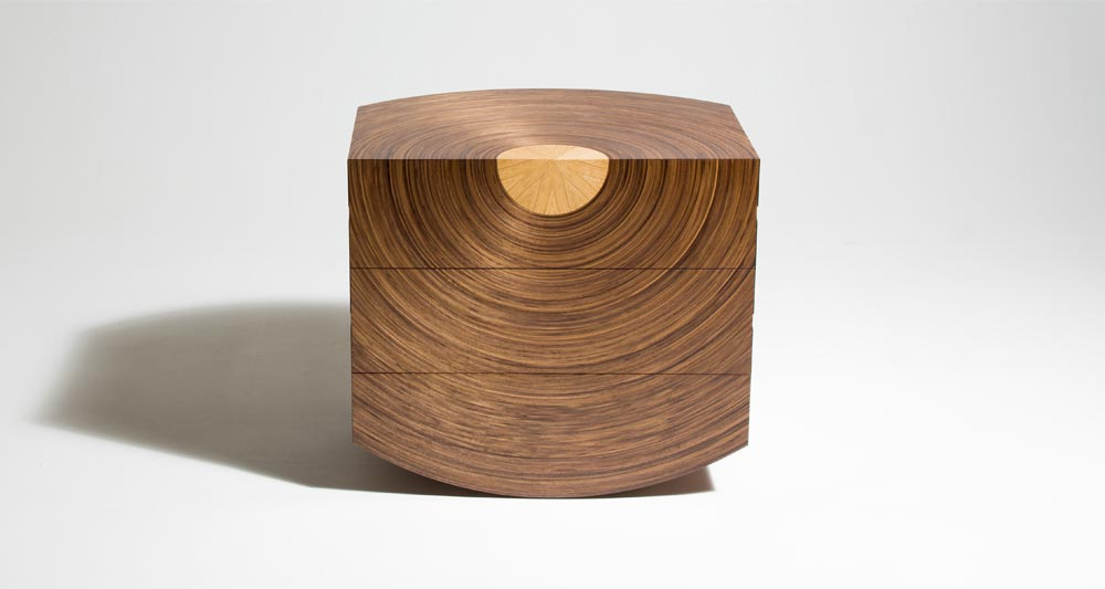 Front view of Centrum chest of drawers. Showing our curved Murano veneers in walnut radiating out from a central oak core.