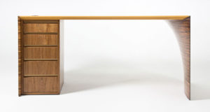 Front view of the Radium III desk made in walnut with deep yellow leather top.