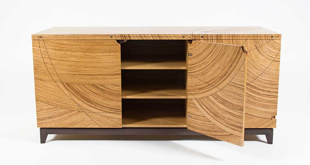 A front elevation view of the sewing desk with the centre door open showing storage shelves.