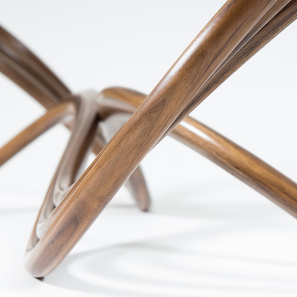 Detail of Ligamentum coffee table showing curved legs.