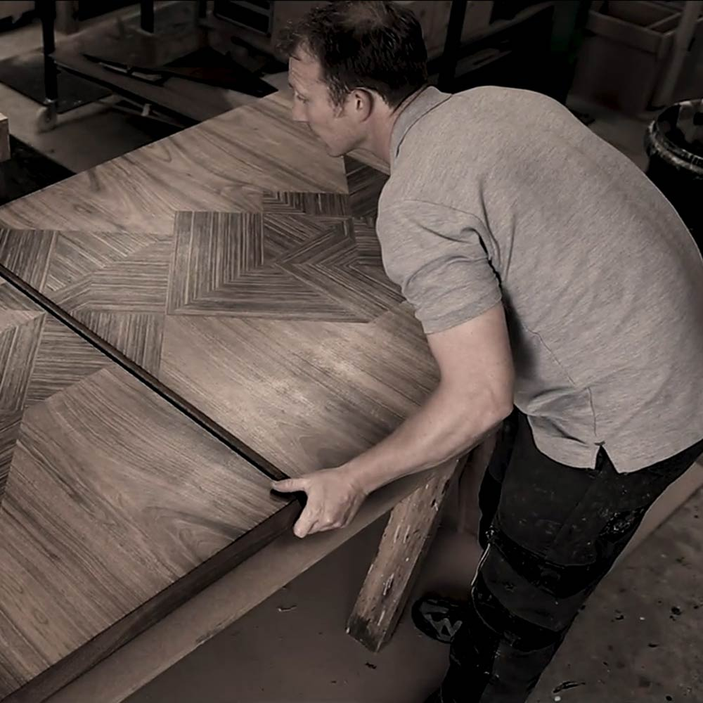 Edward Johnson working on the Murano Cento dining table in the workshop.
