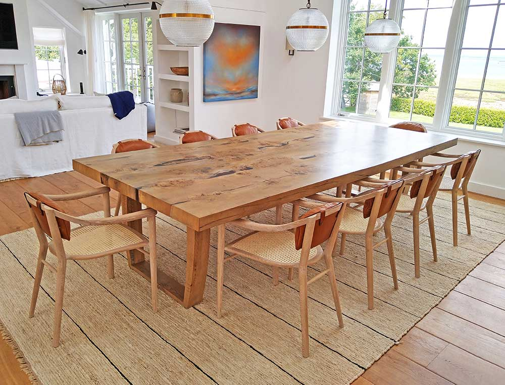 Sussex chairs shown around an oak table in a dining room.